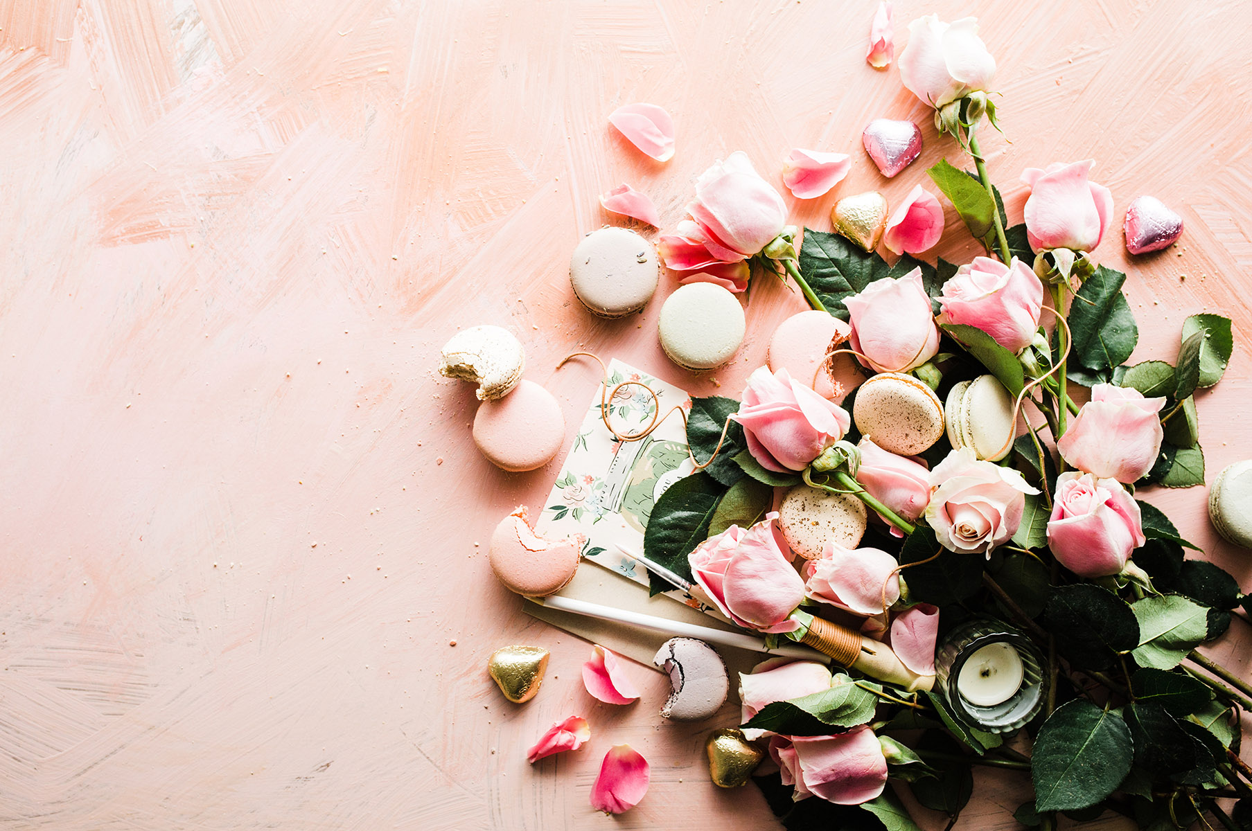 pink roses, with pink and white macarons and green leafery